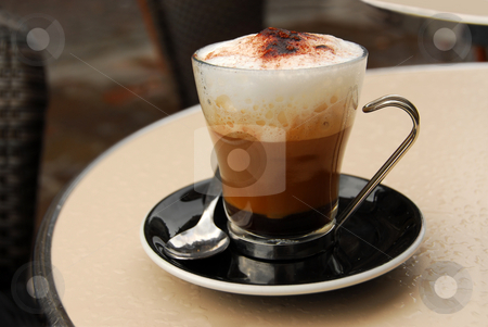 Cappuccino stock photo, Cup of coffee on outdoor patio table by Elena Elisseeva