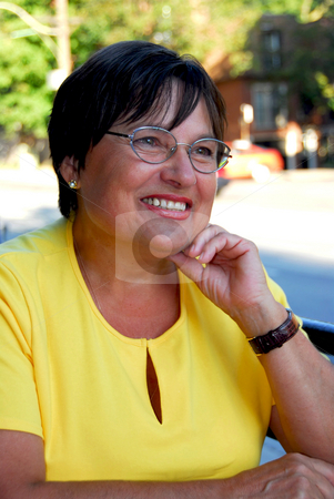 Mature woman portait stock photo, Portrait of mature woman in outdoor cafe by Elena Elisseeva