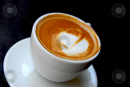 Coffee heart stock photo, Cappuccino with heart shape on foam by Elena Elisseeva