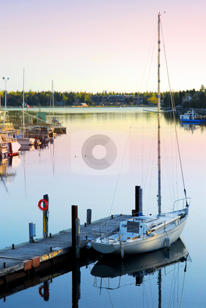 Yacht at sunrise stock photo, Yacht at the wooden dock in early morning in Tobermory Ontario Canada by Elena Elisseeva