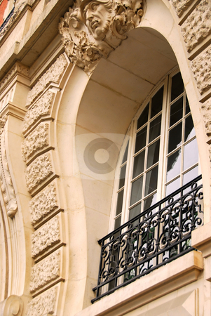 Old window stock photo, Rounded ornate window with wrought iron grid in Paris France by Elena Elisseeva