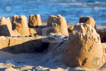 Sand castle stock photo, Sand castle on a beach by Elena Elisseeva
