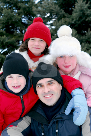 Family portrait stock photo, Portrait of a happy family in winter park by Elena Elisseeva