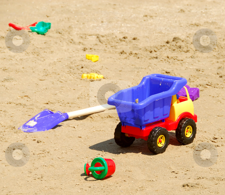 Beach toys stock photo, Children's sand plastic toys on a beach by Elena Elisseeva