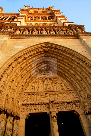Notre Dame de Paris stock photo, Cathedral of Notre Dame de Paris in evening sun, fragment by Elena Elisseeva