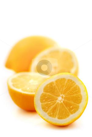 Lemons stock photo, Several lemon halves isolated on white background by Elena Elisseeva