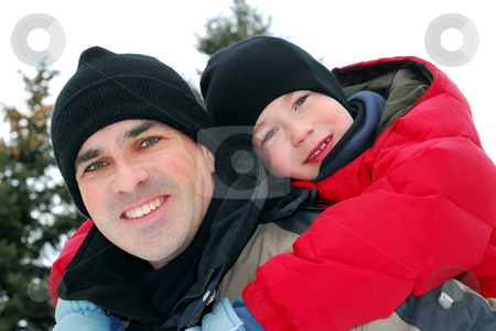 Father and son stock photo, Portrait of father and son playing in winter park by Elena Elisseeva