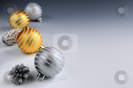 Christmas ornaments stock photo, Christmas arrangement with glass bauble ornaments and pine cones, background by Elena Elisseeva