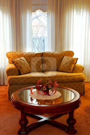 Living room interior stock photo, Interior of a cozy living room with sofa and coffee table by Elena Elisseeva