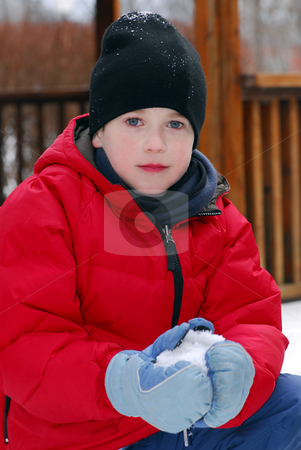 Winter boy stock photo, Portrait of a boy making a snowball in winter park by Elena Elisseeva
