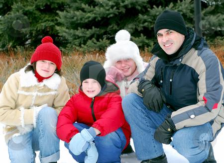 Family portrait stock photo, Portrait of a happy family in winter park by Elena Elisseeva