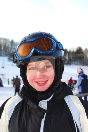 Girl ski stock photo, Portrait of a happy girl on downhill ski resort by Elena Elisseeva