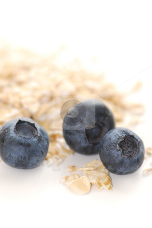 Blueberry oats stock photo, Blueberries and oats macro on white background by Elena Elisseeva