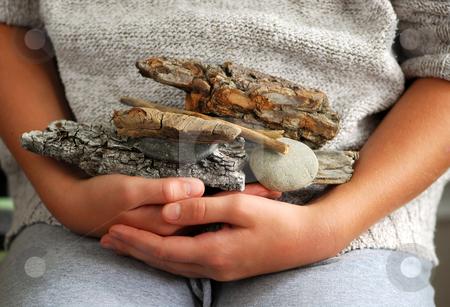 Beach treasures stock photo, Child hands holding beach treasures collected on sea shore by Elena Elisseeva