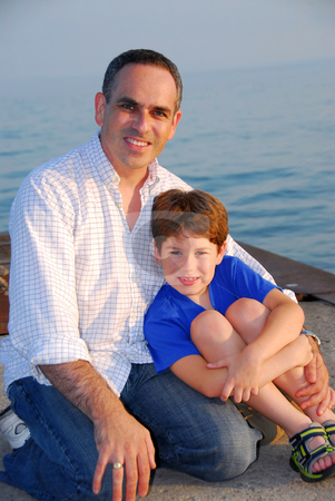 Father son pier stock photo, Portrait of a father and son on a pier by Elena Elisseeva