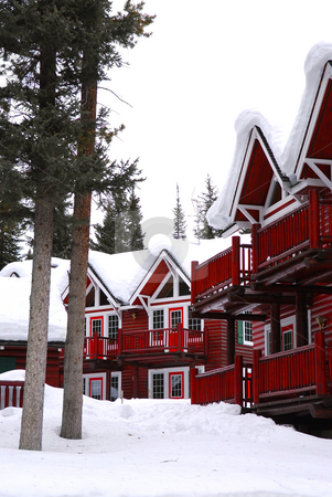 Winter lodge stock photo, Log buildings of a mountain lodge in winter at ski resort by Elena Elisseeva
