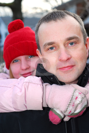 Father daughter stock photo, Portait of a father and a daughter outside in winter by Elena Elisseeva