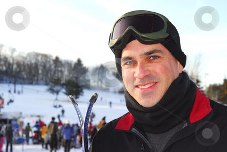 Man ski stock photo, Portrait of a happy attractive man on downhill ski resort by Elena Elisseeva