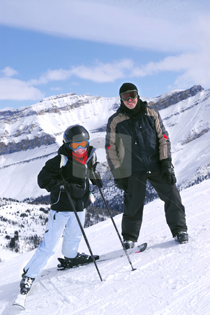 Skiing in mountains stock photo, Family downhill skiing vacation - father and daughter in scenic winter Rocky mountains by Elena Elisseeva