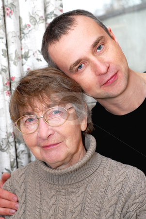 Mother and son stock photo, Portrait of a retired mother and her son by Elena Elisseeva