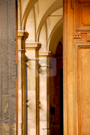 Doors stock photo, Arches seen through half open old wooden door by Elena Elisseeva