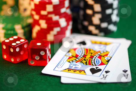 Gambling stock photo, Stacks of gambling chips, playing cards and dice on green background by Elena Elisseeva