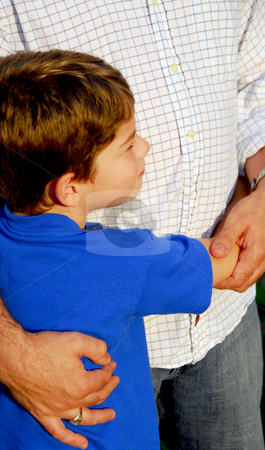 Father and son stock photo, Little boy hugging his father by Elena Elisseeva
