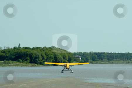 Take-off stock photo, A small plane taking off from a large river by Richard Nelson