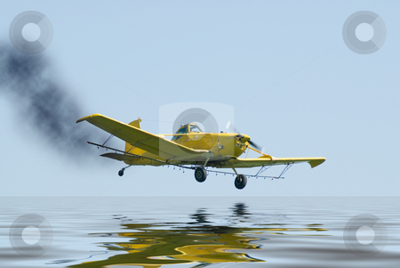 Crash Landing stock photo, A small plane on fire and about to crash into some water by Richard Nelson