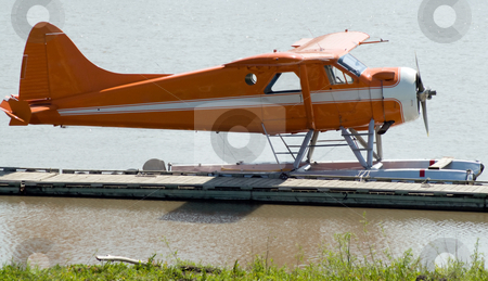 Small Plane stock photo, A small water plane docked on the river during the day by Richard Nelson