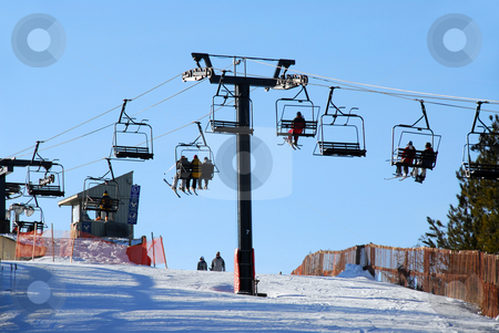 Downhill skiing stock photo, Chairlift with skiers on downhill ski resort by Elena Elisseeva