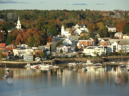 Bucksport, Maine fall colors  stock photo, Historic Bucksport, Maine on the Penobscot River is a colorful inland shipping port and one of the gateways to Arcadia National Park via U.S. Route 1.  This harbor view from across the river is like a picture postcard (October, 2007). by Dennis Thomsen