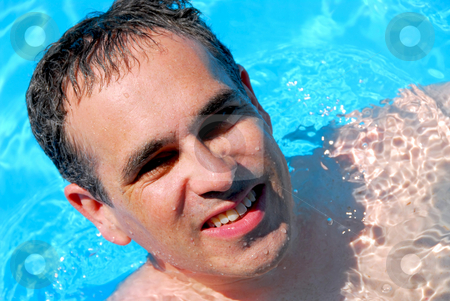 Man swimming pool stock photo, Portrait of a happy man in a swimming pool by Elena Elisseeva