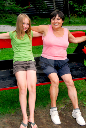 Family on swings stock photo, Grandmother and granddaughter on swings by Elena Elisseeva
