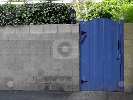 A blue gate stock photo, A blue fence set into a greey brick wall. by Rob Wright