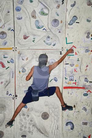 Rock climber stock photo, Male rock climber inside an indoor rock climbing wall by Jonas Marcos San Luis