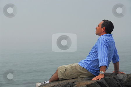 Man looking fog stock photo, Man looking at the foggy ocean. Uncertain future concept. by Elena Elisseeva