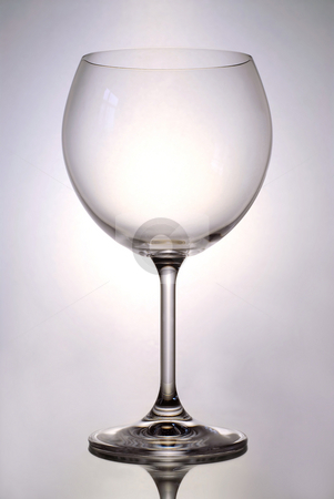 Wine glass stock photo, Single empty glass for red wine on reflective surface by Elena Elisseeva