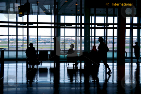 Airport travelers stock photo, People waiting at the airport terminal by Elena Elisseeva