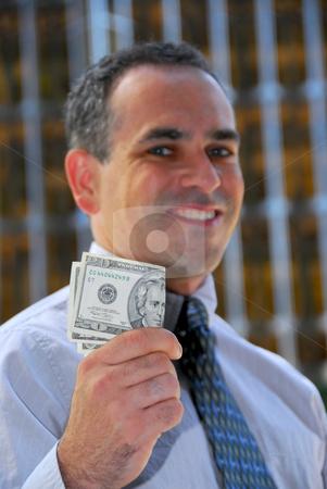 Businessman hold money stock photo, Businessman holding money by Elena Elisseeva