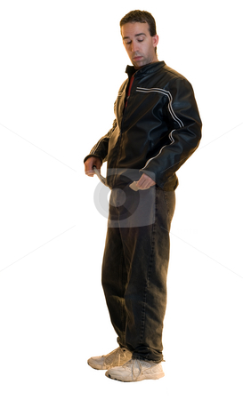 Broke stock photo, A young man showing that his pockets are empty and he is broke by Richard Nelson