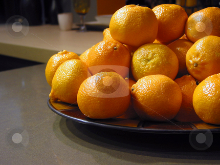 Oranges in a bowl stock photo, Oranges in a bowl on kitchen countertop by Elena Elisseeva