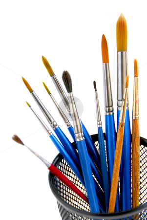 Paintbrushes holder stock photo, Paintbrushes in a metal mesh holder on white background by Elena Elisseeva