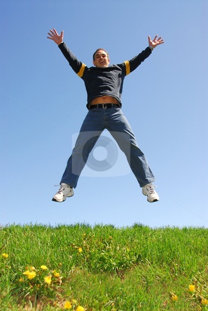 Man jumping happy stock photo, Happy man jumping on green grass by Elena Elisseeva