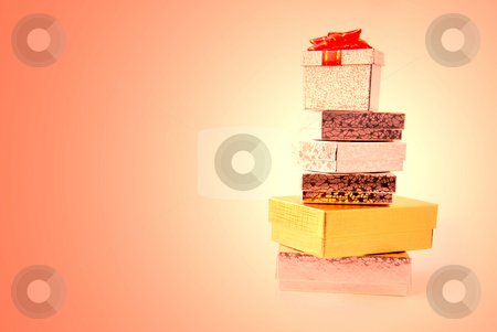 Gift boxes stock photo, Stacked gift boxes on colored background by Elena Elisseeva