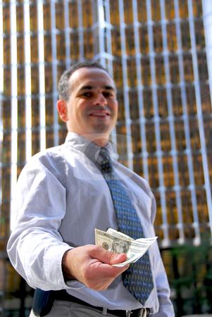 Businessman offer money stock photo, Businessman offering money by Elena Elisseeva