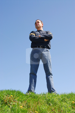Looking to the future stock photo, Man standing on top of a hill, looking to the future by Elena Elisseeva