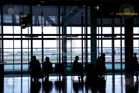 Airport travelers stock photo, People waiting at the international airport terminal by Elena Elisseeva