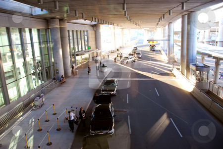 Airport terminal stock photo, Travelers getting taxis at airport by Elena Elisseeva
