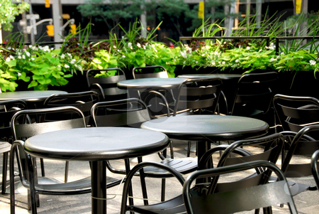 Restaurant patio stock photo, Restaurant outdoor patio with black patio firniture by Elena Elisseeva
